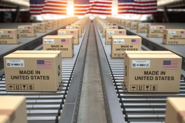 Made in USA United States. Cardboard boxes with text made in USA and american flag on the roller conveyor. 3d illustration